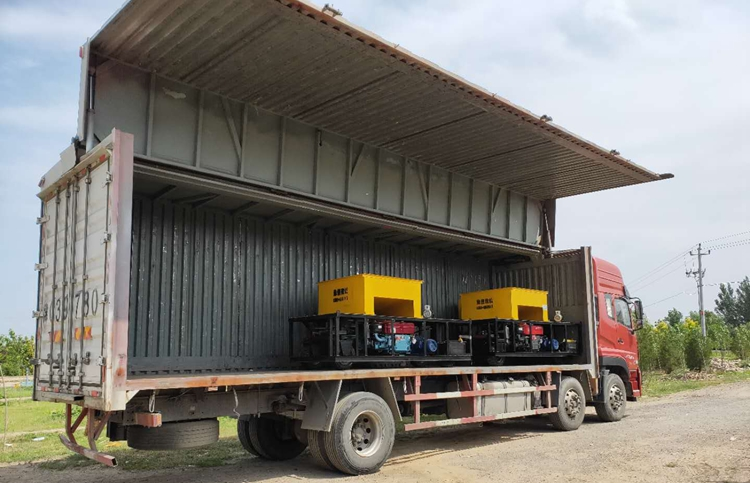 Slipform curb machine delivery