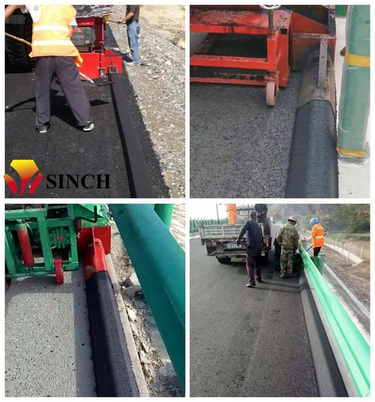 Asphalt curb machine working site